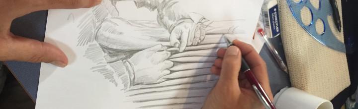 Niklas on board HMS Gladan make drawings to their new book